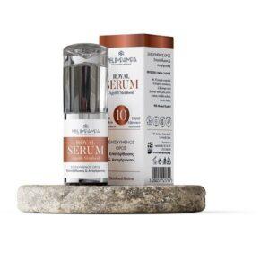 Royal serum ορός αντιγήρανσης για το πρόσωπο το μπουκαλάκι μαζί με τη συσκευασία πάνω σε πέτρα